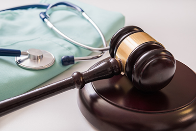 A gavel and stethoscope